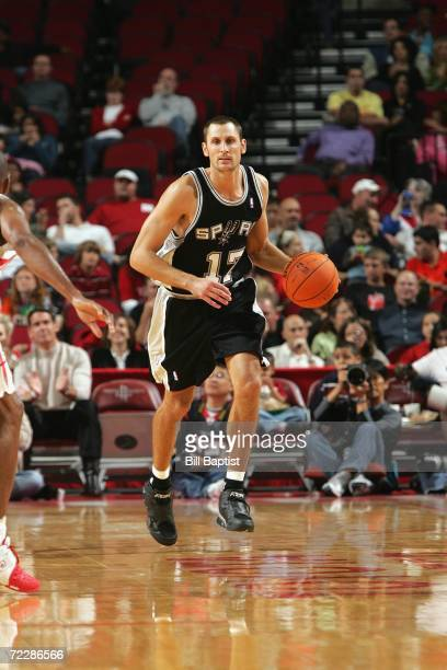 Brent Barry of the San Antonio Spurs dribbles the ball upcourt against the Houston Rockets during the preseason game at the Toyota Center on October...