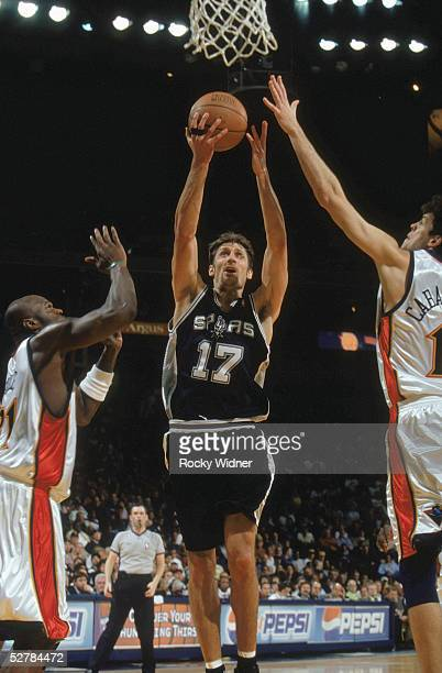Brent Barry of the San Antonio Spurs shoots a layup during the game with the Golden State Warriors at The Arena in Oakland on April 10 2005 in...