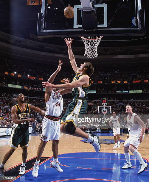 Brent Barry of the Seattle Sonics makes a layup against Derrick Coleman of the Philadelphia 76ers at First Union Center on December 11, 2002 in...