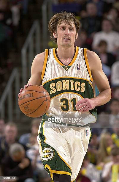 Brent Barry of the Seattle Sonics moves the ball during the game against the Los Angeles Lakers on April 2 2004 at Key Arena in Seattle Washington...
