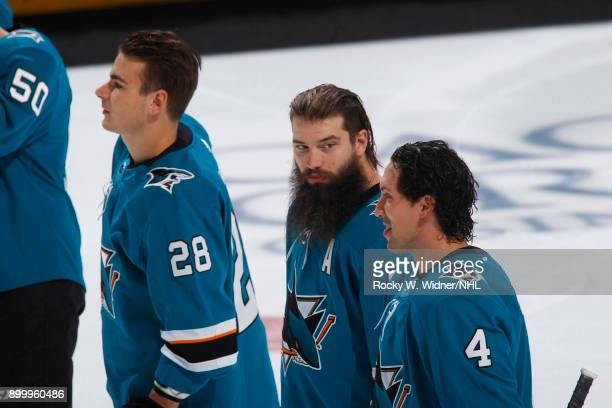 Brent Burns and Brenden Dillon of the San Jose Sharks look on prior to the game against the Vancouver Canucks at SAP Center on December 21 2017 in...
