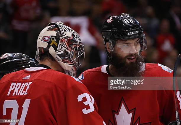 Brent Burns and Carey Price of Team Canada celebrate their 31 over Team Europe during Game One of the World Cup of Hockey 2016 final series at the...