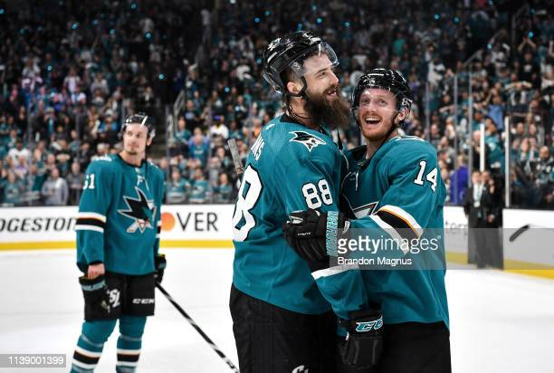 Brent Burns and Gustav Nyquist of the San Jose Sharks celebrate the win against the Vegas Golden Knights in Game Seven of the Western Conference...