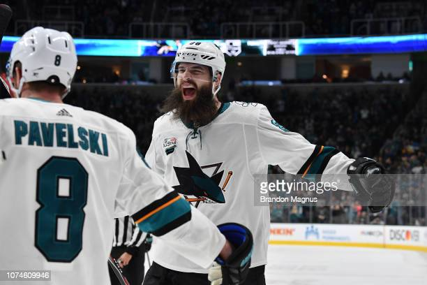 Brent Burns and Joe Pavelski of the San Jose Sharks celebrate a gametying goal against the Los Angeles Kings at SAP Center on December 22 2018 in San...