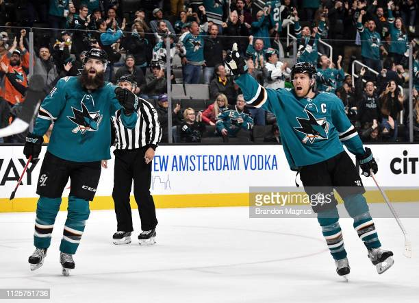 Brent Burns and Joe Pavelski of the San Jose Sharks celebrate after scoring against the Boston Bruins at SAP Center on February 18 2019 in San Jose...