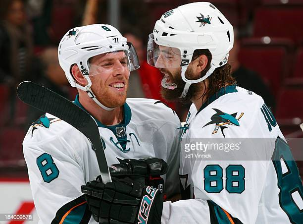 Brent Burns and Joe Pavelski of the San Jose Sharks celebrate their win during their NHL game against the Vancouver Canucks at Rogers Arena on...