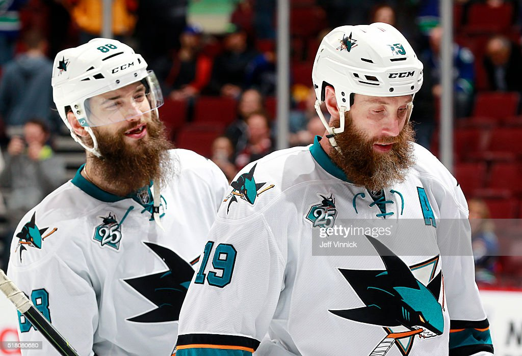 Brent Burns #88 and Joe Thornton #19 of the San Jose Sharks leave the ice after defeating the Vancouver Canucks in their NHL game at Rogers Arena March 29, 2016 in Vancouver, British Columbia, Canada. San Jose won 4-1.