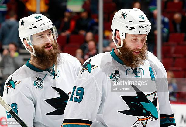 Brent Burns and Joe Thornton of the San Jose Sharks leave the ice after defeating the Vancouver Canucks in their NHL game at Rogers Arena March 29...