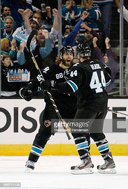 Brent Burns and Marc-Edouard Vlasic of the San Jose Sharks celebrate after Burns scored a goal against the Los Angeles Kings in the first period in...