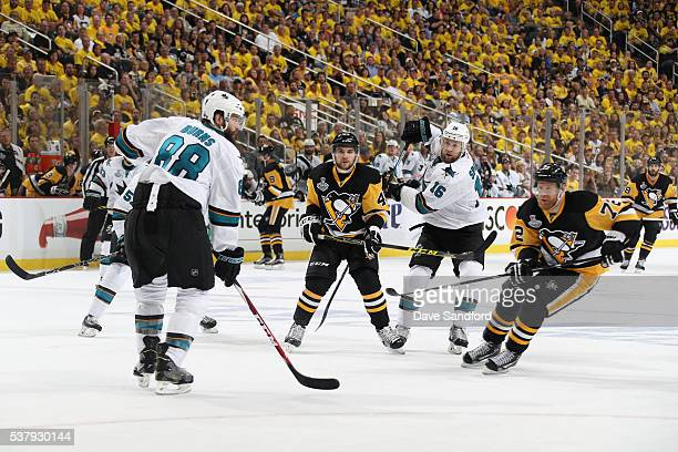 Brent Burns and Nick Spaling of the San Jose Sharks and Conor Sheary and Patric Hornqvist of the Pittsburgh Penguins watch the puck during Game Two...