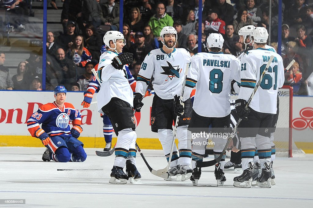 Brent Burns #88, Joe Pavelski #8 and Justin Braun #61 of the San Jose Sharks celebrate after a goal in a game against the Edmonton Oilers on March 25, 2014 at Rexall Place in Edmonton, Alberta, Canada.