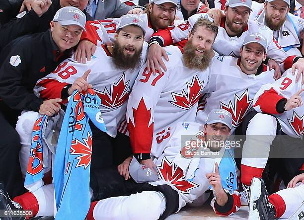 Brent Burns Joe Thornton Patrice Bergeron and Brad Marchand of Team Canada celebrate their victory over Team Europe in Game Two of the World Cup of...