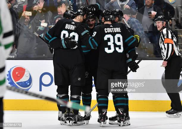 Brent Burns Joonas Donskoi and Logan Couture of the San Jose Sharks celebrate a goal against the Dallas Stars at SAP Center on December 13 2018 in...