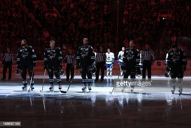 Brent Burns, Matt Irwin, Joe Thornton, T.J. Galiardi and Dan Boyle of the San Jose Sharks stand attended before Game Four of the Western Conference...