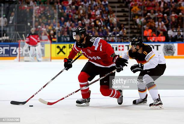 Brent Burns of Canada and Tobias Rieder of Germany battle for the puck during the IIHF World Championship group A match between Canada and Germany on...