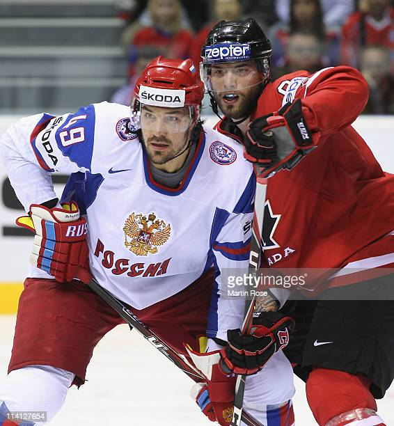 Brent Burns of Canada skates against Yevgeni Artyukhin of Russia during the IIHF World Championship quarter final match between Canada and Russia at...
