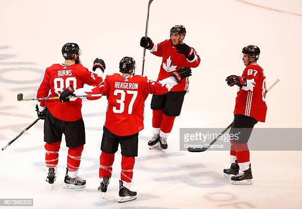 Brent Burns of Team Canada celebrates his first period goal with Patrice Bergeron Sidney Crosby and Brad Marchand while playing Team Czech Republic...