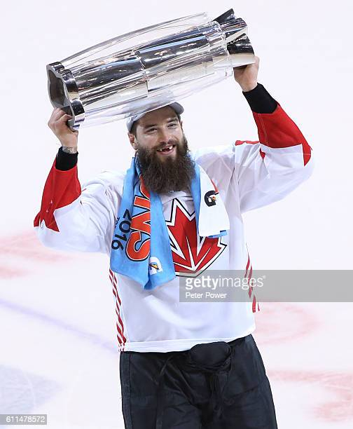 Brent Burns of Team Canada celebrates with the trophy after his teams World Cup of Hockey Championship over Team Europe during Game Two of the World...