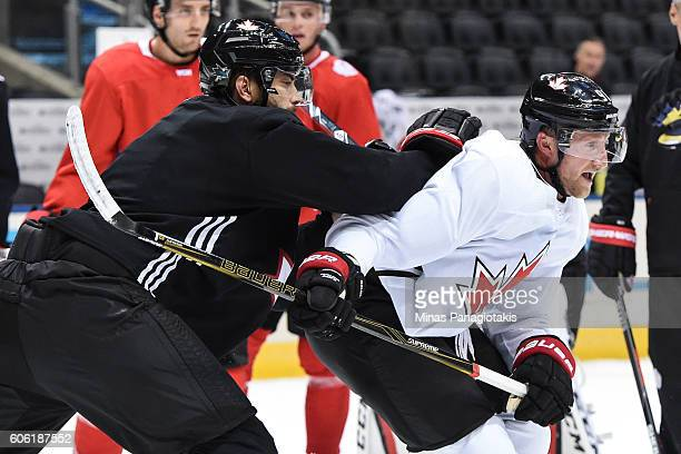 Brent Burns of Team Canada challenges Steven Stamkos during practice at the World Cup of Hockey 2016 at Air Canada Centre on September 16, 2016 in...
