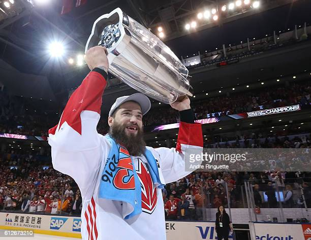Brent Burns of Team Canada hoists the World Cup of Hockey trophy during Game Two of the World Cup of Hockey final series at the Air Canada Centre on...
