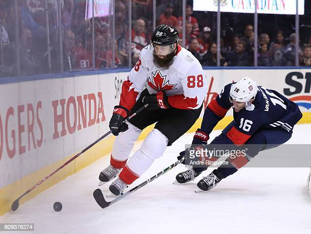 Brent Burns of Team Canada stickhandles the puck with James Van Riemsdyk of Team USA chasing during the World Cup of Hockey 2016 at Air Canada Centre...