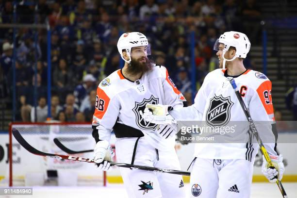 Brent Burns of the San Jose Sharks and Connor McDavid of the Edmonton Oilers react after a play during theduring the second half of the 2018 Honda...