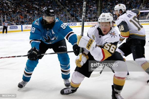 Brent Burns of the San Jose Sharks and Erik Haula of the Vegas Golden Knights battle along the boards in Game Three of the Western Conference Second...