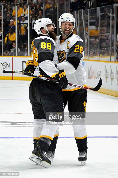 Brent Burns of the San Jose Sharks and John Scott of the Arizona Coyotes celebrate a goal during the Western Conference Semifinal Game between the...