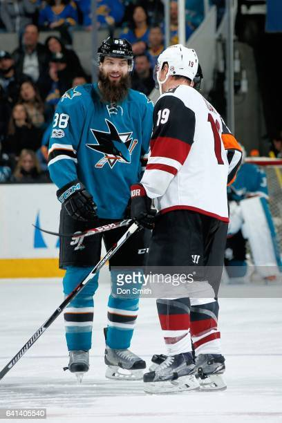 Brent Burns of the San Jose Sharks and Shane Doan of the Arizona Coyotes chat during a NHL game at San Jose on February 4 2017 in San Jose California