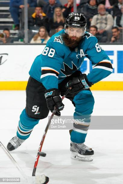 Brent Burns of the San Jose Sharks battles for the puck during a NHL game against the Arizona Coyotes at SAP Center on February 13 2018 in San Jose...