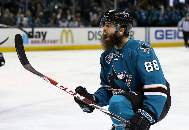 Brent Burns of the San Jose Sharks celebrates after he scored a goal in...
