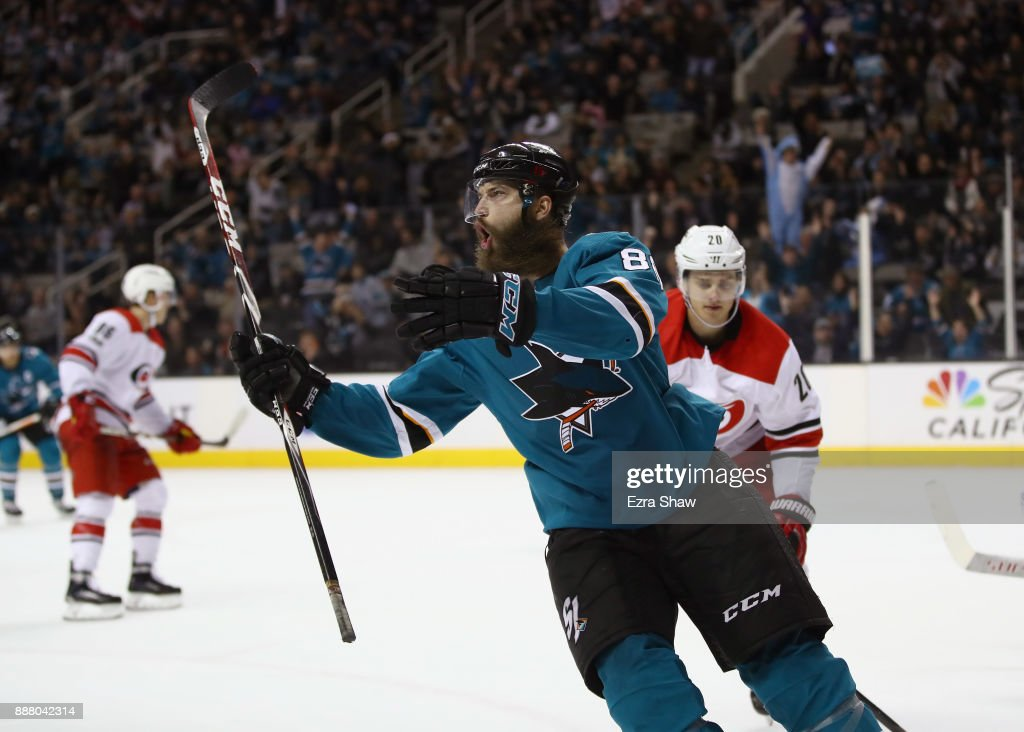 Brent Burns #88 of the San Jose Sharks celebrates after he scored the game-winning goal on Cam Ward #30 of the Carolina Hurricanes in overtime at SAP Center on December 7, 2017 in San Jose, California.