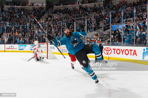 Brent Burns of the San Jose Sharks celebrates after scoring the gamewinning goal in overtime against the Carolina Hurricanes at SAP Center on...