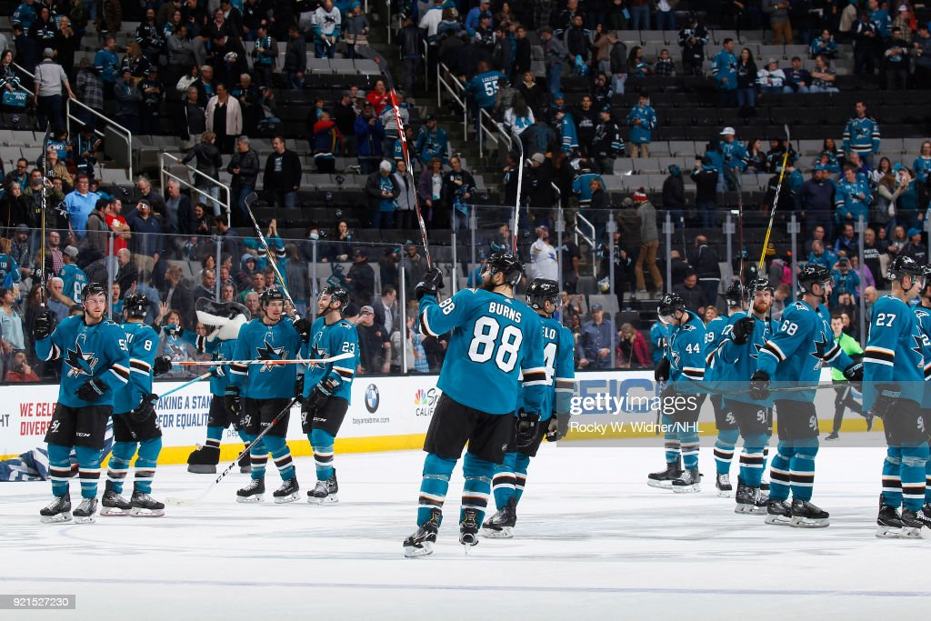 Brent Burns #88 of the San Jose Sharks celebrates alongside teammates after defeating the Vancouver Canucks at SAP Center on February 15, 2018 in San Jose, California.