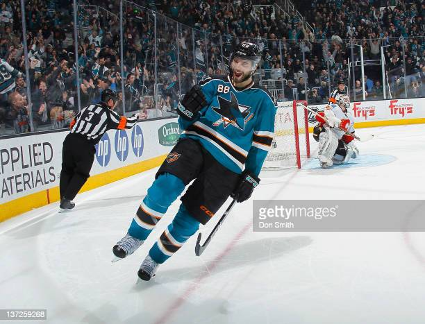 Brent Burns of the San Jose Sharks celebrates his gamewinning shoot out goal against Miikka Kiprusoff of the Calgary Flames at HP Pavilion on January...
