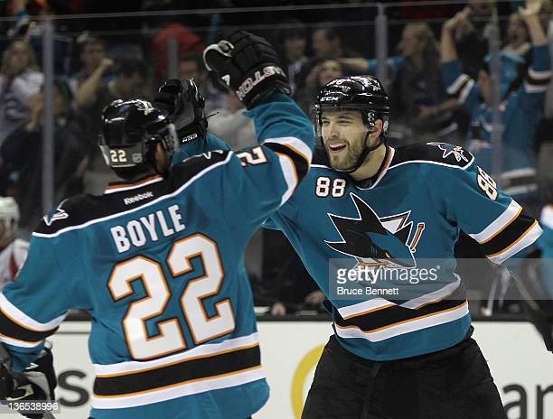 Brent Burns of the San Jose Sharks celebrates his power play goal at 1951 of the second period along with Dan Boyle in their game against the...