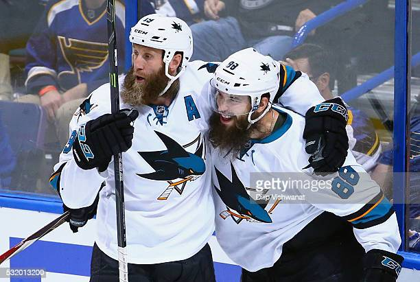 Brent Burns of the San Jose Sharks celebrates with Joe Thornton after scoring a second period goal against Brian Elliott of the St Louis Blues in...