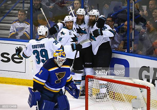 Brent Burns of the San Jose Sharks celebrates with Joe Thornton Joe Pavelski and Logan Couture after scoring a second period goal against Brian...