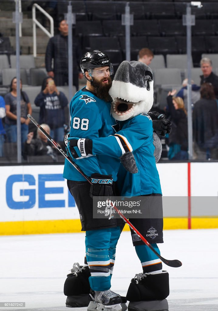 Brent Burns #88 of the San Jose Sharks celebrates with mascot S.J. Sharkie after defeating the Vancouver Canucks at SAP Center on February 15, 2018 in San Jose, California.