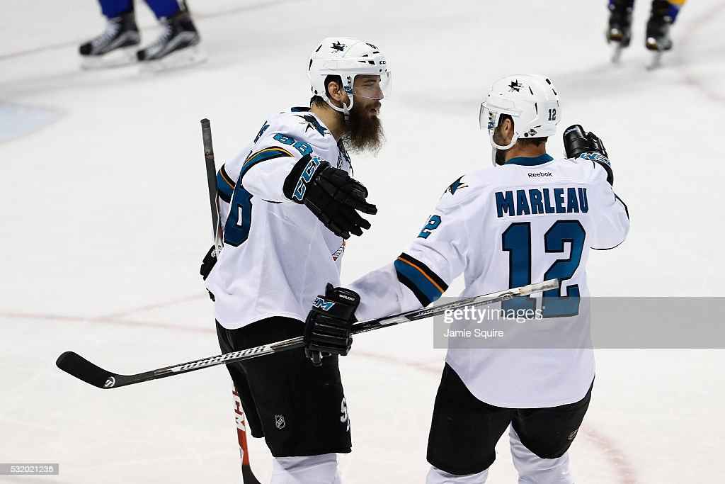 Brent Burns #88 of the San Jose Sharks celebrates with Patrick Marleau #12 after scoring a third period goal against Brian Elliott #1 of the St. Louis Blues (not pictured) in Game Two of the Western Conference Final during the 2016 NHL Stanley Cup Playoffs at Scottrade Center on May 17, 2016 in St Louis, Missouri.