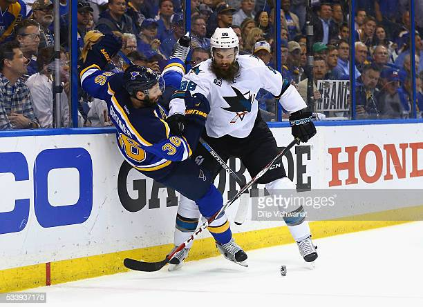 Brent Burns of the San Jose Sharks checks Troy Brouwer of the St Louis Blues during the third period in Game Five of the Western Conference Final...