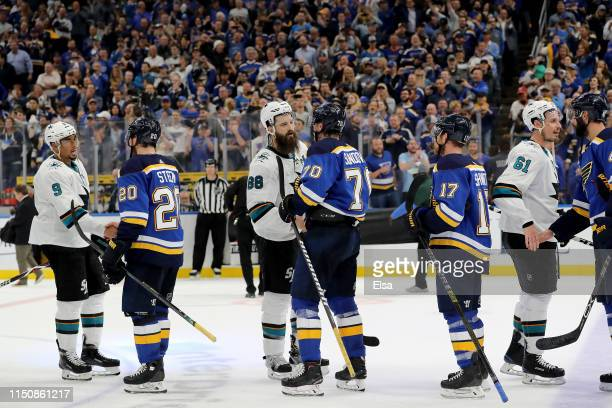 Brent Burns of the San Jose Sharks congratulates Oskar Sundqvist of the St Louis Blues after Game Six of the Western Conference Finals during the...
