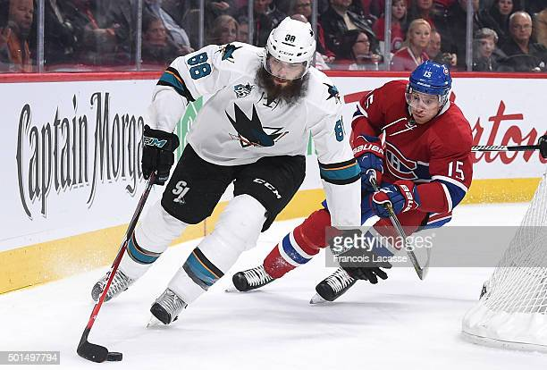 Brent Burns of the San Jose Sharks controls the puck against Tomas Fleischmann of the Montreal Canadiens in the NHL game at the Bell Centre on...