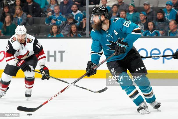 Brent Burns of the San Jose Sharks controls the puck during a NHL game against the Arizona Coyotes at SAP Center on February 13 2018 in San Jose...