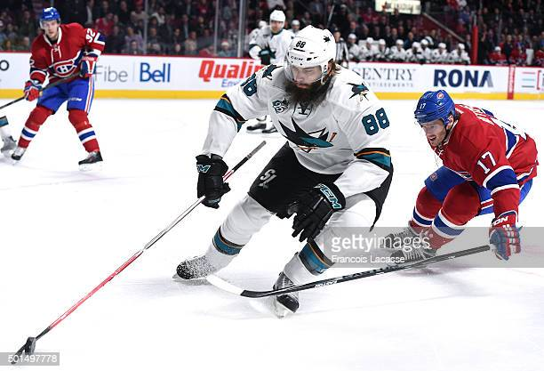 Brent Burns of the San Jose Sharks controls the puck while being challenged by Torrey Mitchell the Montreal Canadiens in the NHL game at the Bell...