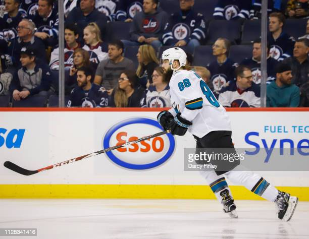Brent Burns of the San Jose Sharks follows the play up the ice during first period action against the Winnipeg Jets at the Bell MTS Place on February...