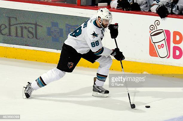 Brent Burns of the San Jose Sharks handles the puck against the Washington Capitals at the Verizon Center on January 14 2014 in Washington DC