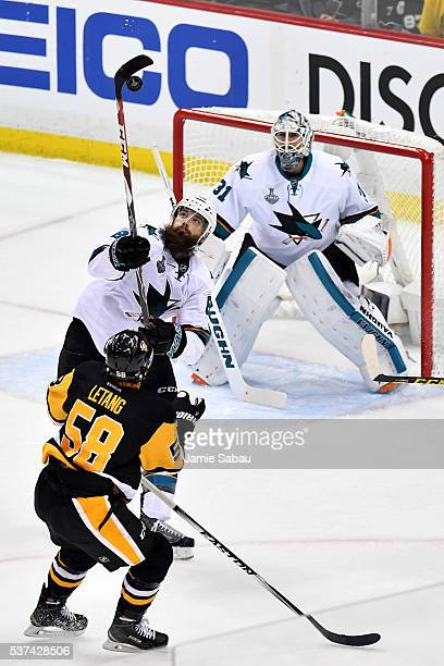 Brent Burns of the San Jose Sharks handles the puck in the air during the first period against the Pittsburgh Penguins in Game Two of the 2016 NHL...