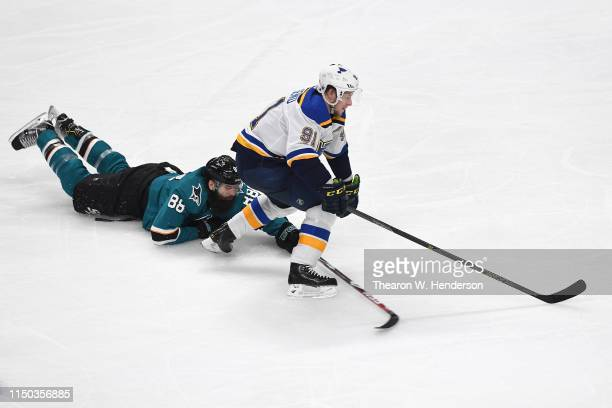 Brent Burns of the San Jose Sharks interferes with Vladimir Tarasenko of the St Louis Blues in Game Five of the Western Conference Final during the...