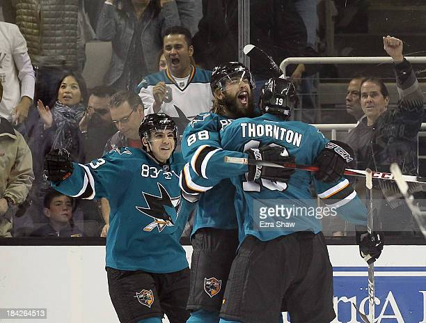 Brent Burns of the San Jose Sharks is congratulated by Joe Thornton and Matt Nieto after he scored the goahead goal in the third period of their game...